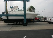 Boat Being Placed on Trailer with Boat Lift